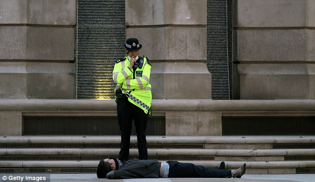 Well, well, well... what do we have here? A British police officer ponders her next move with an activist by St Paul's Cathedral in London