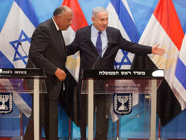 Egyptian FM Sameh Shoukry and Israeli PM Benjamin Netanyahu, AP photo