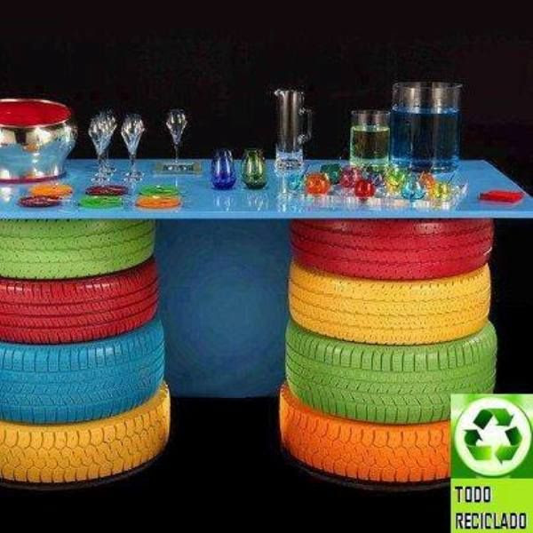 Recycling tires to create a fun table.