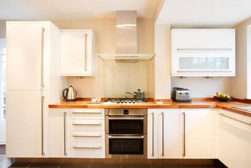 Give New Life to Laminate: Fresh Paint for Kitchen Cabinets