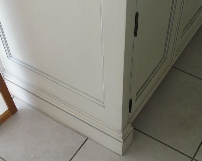 Whether To Continue Baseboard Onto A Bathroom Vanity