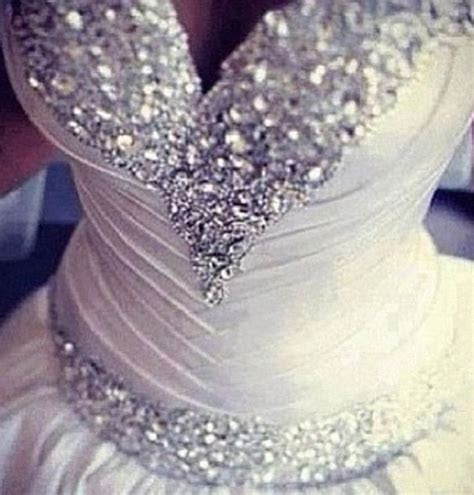 Stunning. Bedazzled wedding dress. Ball gown shaped fit