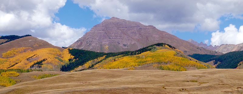 13,208 foot Teocalli Mountain rises east of Crested Butte, Colorado.  14,265 foot Castle Peak peeks over Teocalli's east ridge.