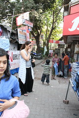 Street Urchins-This  Young Lady Bought Them Jeans by firoze shakir photographerno1