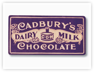 The first purple and gold Cadbury Dairy Milk packaging design. It was originally launched in pale mauve and red script.