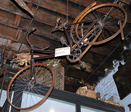An 1885 girl's bike is one of the items hanging from the ceiling at Big Ed's