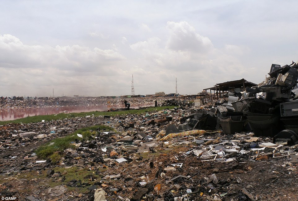 Dumped: E-waste graveyards in Africa (pictured) are damaging the health of the scavengers and the local environment, according to a United Nations University report