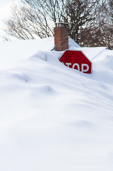 stop sign buried, during the very snowy winter of 2015