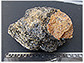 Yellow-orange phosphate mineral Wagnerite in a matrix of biotite mica and other minerals