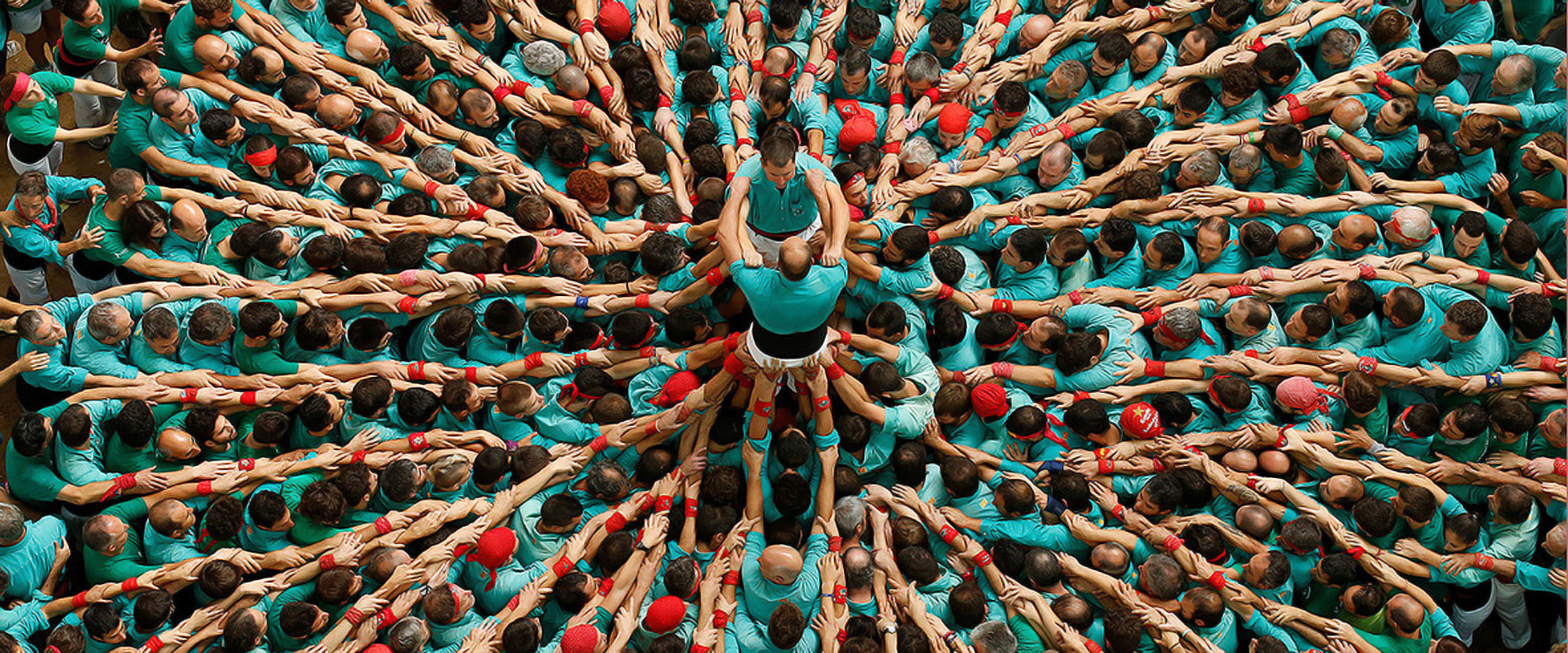 human towers pile up for the for the 26th concurs de castells in catalonia, spain