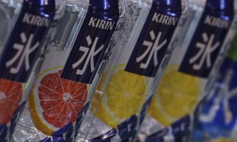 The Kirin logo is seen on its liquor cans at a shop in Tokyo September 28, 2012.  REUTERS/Kim Kyung-Hoon