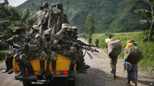 In this 30 November, 2012 file photo, M23 rebels withdraw from the Masisi and Sake areas in eastern Congo.