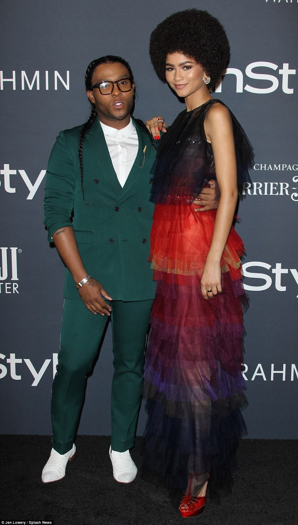 His muse: Zendaya, 21, rocked a large Afro and a colorful layered gown with red heels as she posed for photos with stylist Law Roach
