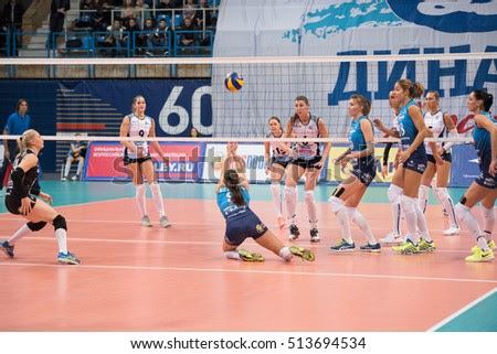 MOSCOW - NOVEMBER 2, 2016: V. Vetrova (9) get a ball and fall down on game Dynamo MSK vs Dynamo KZN on Russian National wemen Volleyball tournament on November 2, in Moscow, Russia, 2016