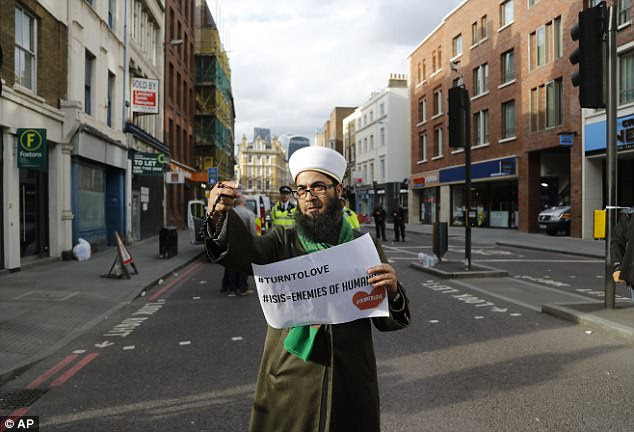 Mr Raza was pictured at a number of points around the cordon yesterday afternoon
