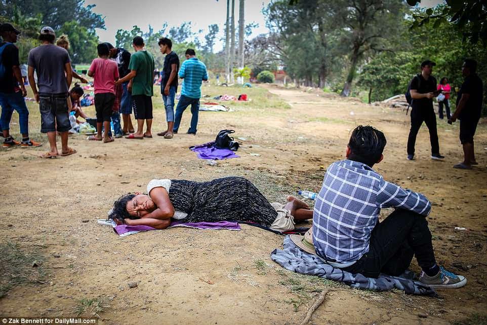 A woman takes a nap outside theFerrocarrilero VÌctor F. Morales Sports Center in MatÌas Romero, Oaxaca, Mexico