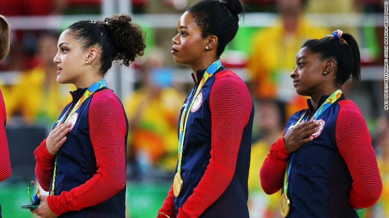 Team USA gold medalists Lauren Hernandez, Gabrielle Douglas and Simone Biles, from left,  during the medal ceremony in Rio.