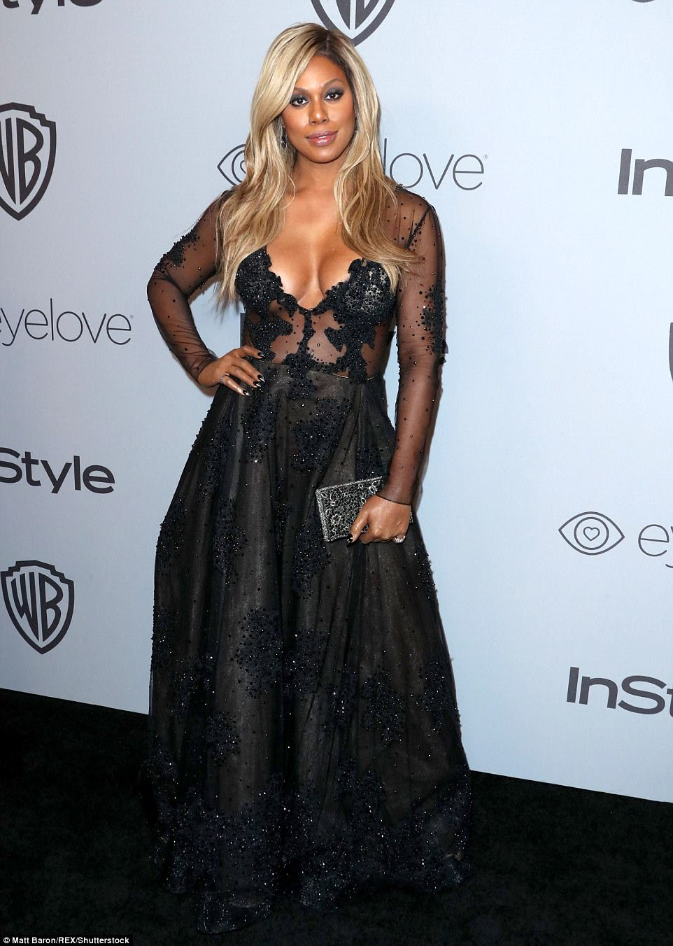 Bombshell: Laverne Cox looked magical in a sparkly gown with sheer bodice and sleeves