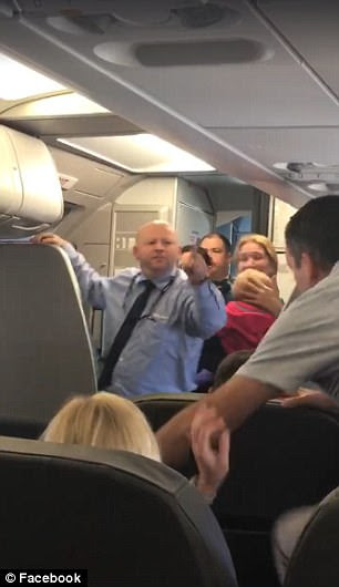 The American Airlines employee challenges a passenger to a fight after the woman was allegedly hit with her stroller