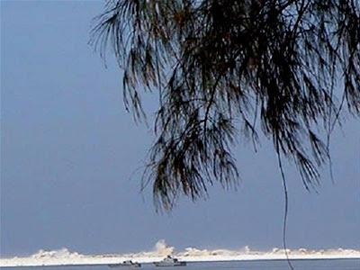 The tsunami nears two ships - Photo by John Knill and Jackie Knill