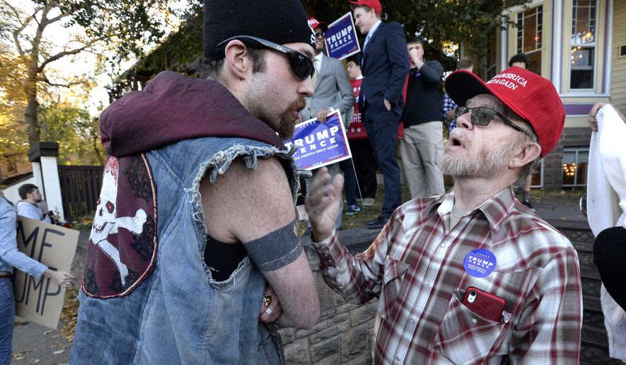 Protester Teague Stroh, left and Elbert Bonner, a supporter for Republican presidential candidate Donald Trump, get into an argument during an appearance by Donald Trump Jr., Trump's son, in Boulder, Colo., Monday, Oct. 17, 2016. (Paul Aiken/Daily Camera via AP)
