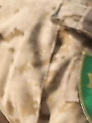 Close-up of the Kurdish militia patch being worn by