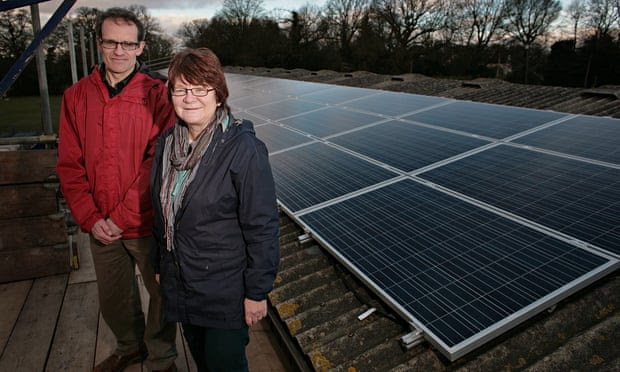 REPOWERBalcombe members Tom Parker and Jackie Emery next to the solar panels on Grange Farm cow shed