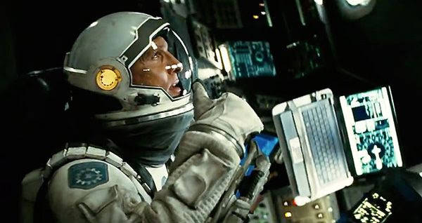Cooper (Matthew McConaughey) leads a small group of astronauts into a wormhole to find a suitable planet that will be the new home for Earth's doomed inhabitants in INTERSTELLAR.