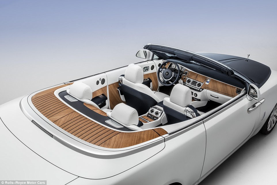A female fan of high-performance yachts wanted her car to replicate her passion for on-sea extravagance. Rolls-Royce listened to her requests and built this nautical themed Dawn