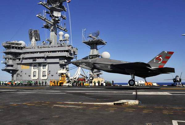 An F-35C Lightning II is about to touch down on the USS Nimitz on November 3, 2014...marking the first time a Joint Strike Fighter jet made an arrested landing aboard an aircraft carrier.