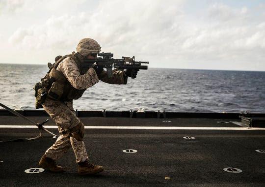 A Marine fires an M4 carbine during a short-range marksmanship