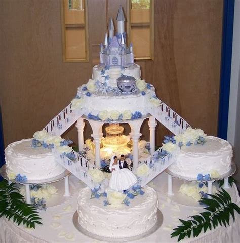 wedding cakes with fountains and stairs  blue roses and