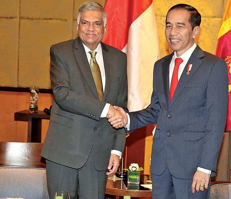 Prime Minister Ranil Wickremesinghe greets Indonesian President Joko Widodo at the Melina Hotel in Vietnam yesterday. Picture by PM's Media Unit.