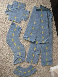 What a great use for old jeans:  portable roads that are easy for kids to put together and will travel easily, made out of old denim and yellow paint. velcro helps them stick to carpet