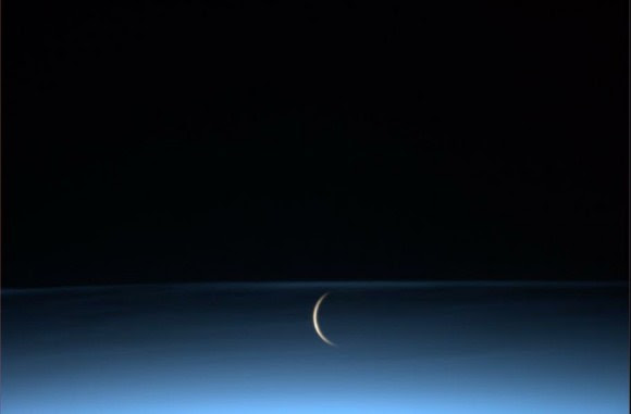 The Moon rises surrounded by noctilucent clouds, as seen from the International Space Station. Credit: NASA/ASI/ESA. Via Luca Parmitano on Twitter.