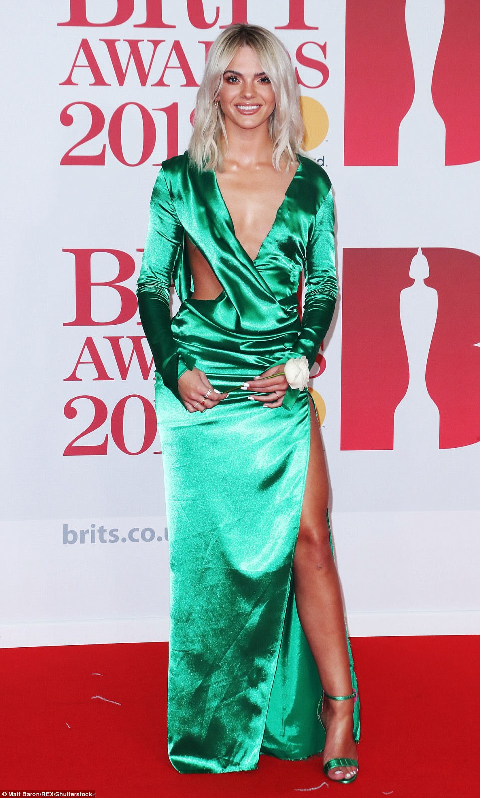 Eye-catching: Rocking up in a metallic emerald dress, Louisa Johnson turned heads in the gown, which featured a variety of intricate cut-outs, teasing her torso and her lean pins