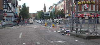 Litter-strewn Shaftsbury Square after the main morning parade