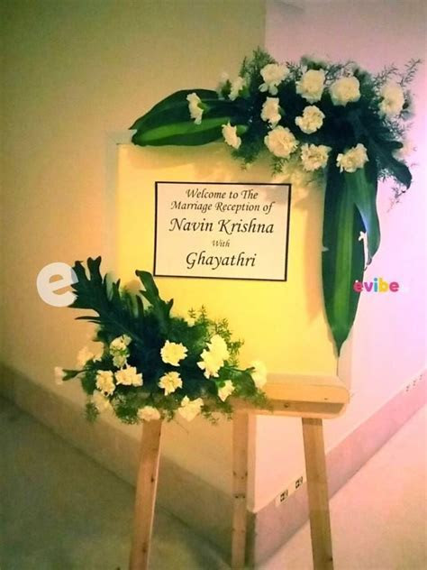 Elegant welcome board with floral decor for wedding