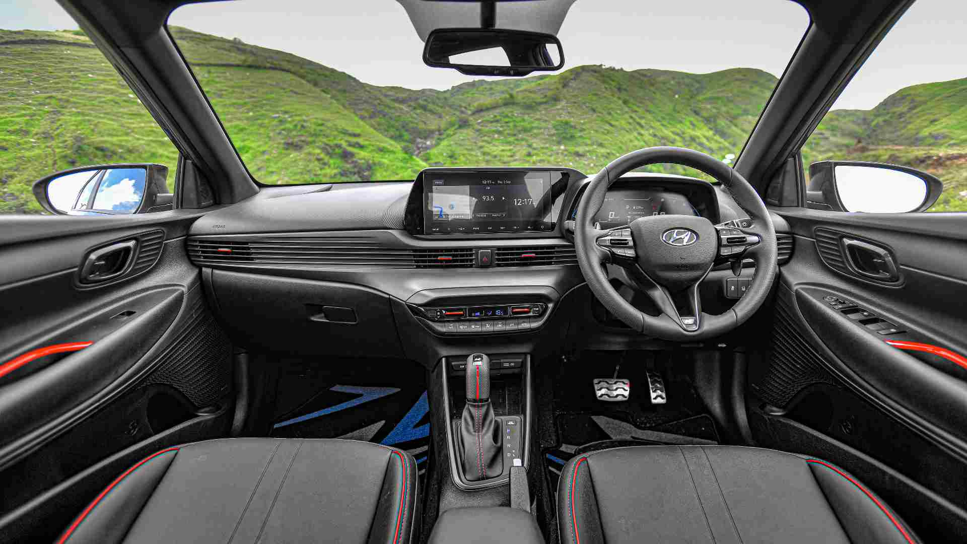 Darkened interior theme with red accents thrown in lends the N Line's insides a sporty, premium vibe. Image: Hyundai