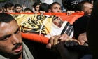 Palestinian mourners carry al-Aqsa Martyrs Brigade commander Hassan al-Madhoun during his funeral