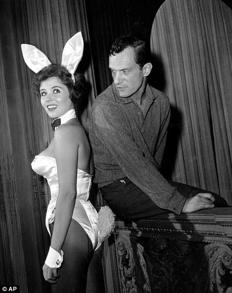 By the 1960s, Hefner was on his way to revolutionizing the way the country dealt with sex. He had opened the first of his Playboy nightclubs and was publishing the magazine regularly. Above, he is pictured with 'bunny girl' hostess Bonnie J. Halpin at the Playboy club in Chicago in 1961