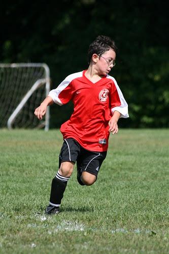 Adam runs down the ball