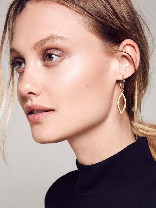 Le Fashion Blog Jewelry Bold Eyebrows Studded Marquise Shaped Hoop Earrings Black Mock Neck Turtleneck Top Via Free People