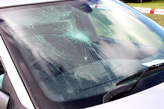 Windshield Damage from Truck Debris: What to Do