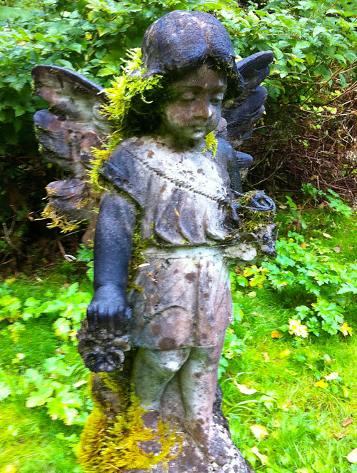 angel on headstone in Kasaan Cemetery, Kasaan, Alaska