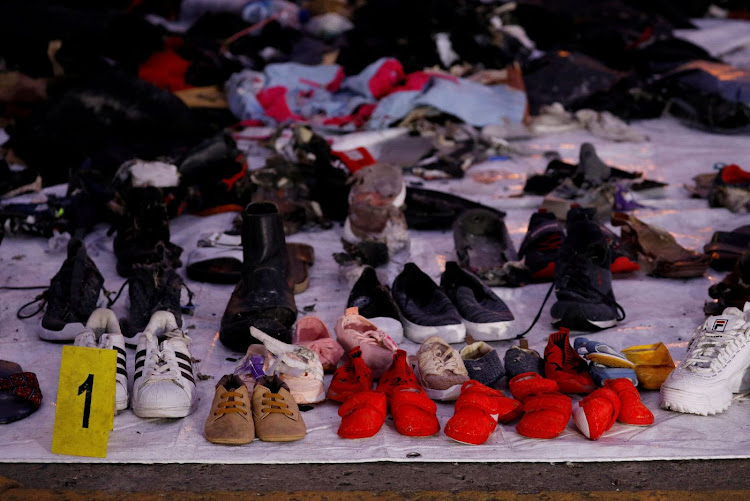 Recovered shoes believed to be from the crashed Lion Air flight JT610 are laid out at Tanjung Priok port in Jakarta, Indonesia, on November 1 2018. Picture: REUTERS/EDGAR SU