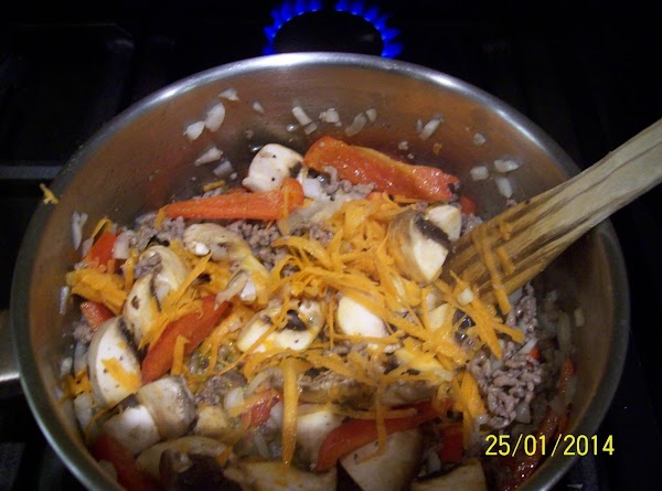 Add to that the onions, grated carrots, red & green peppers, chilli and mushrooms....