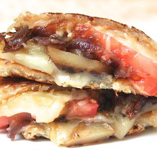 Grilled Cheese W. Gruyere & Swiss, Caramelized Onions, Mushrooms, Truffled Fried Potatoes & Tomato.