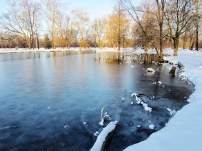 Photo: Ice on a lake with snow at the end of the day at Eastwood Park in Dayton, Ohio.