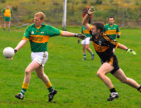 Photo: Cathal McCrann prepares to get a shot away. as Morgan Shanley moves in - Div 1 v Gortletteragh 2009